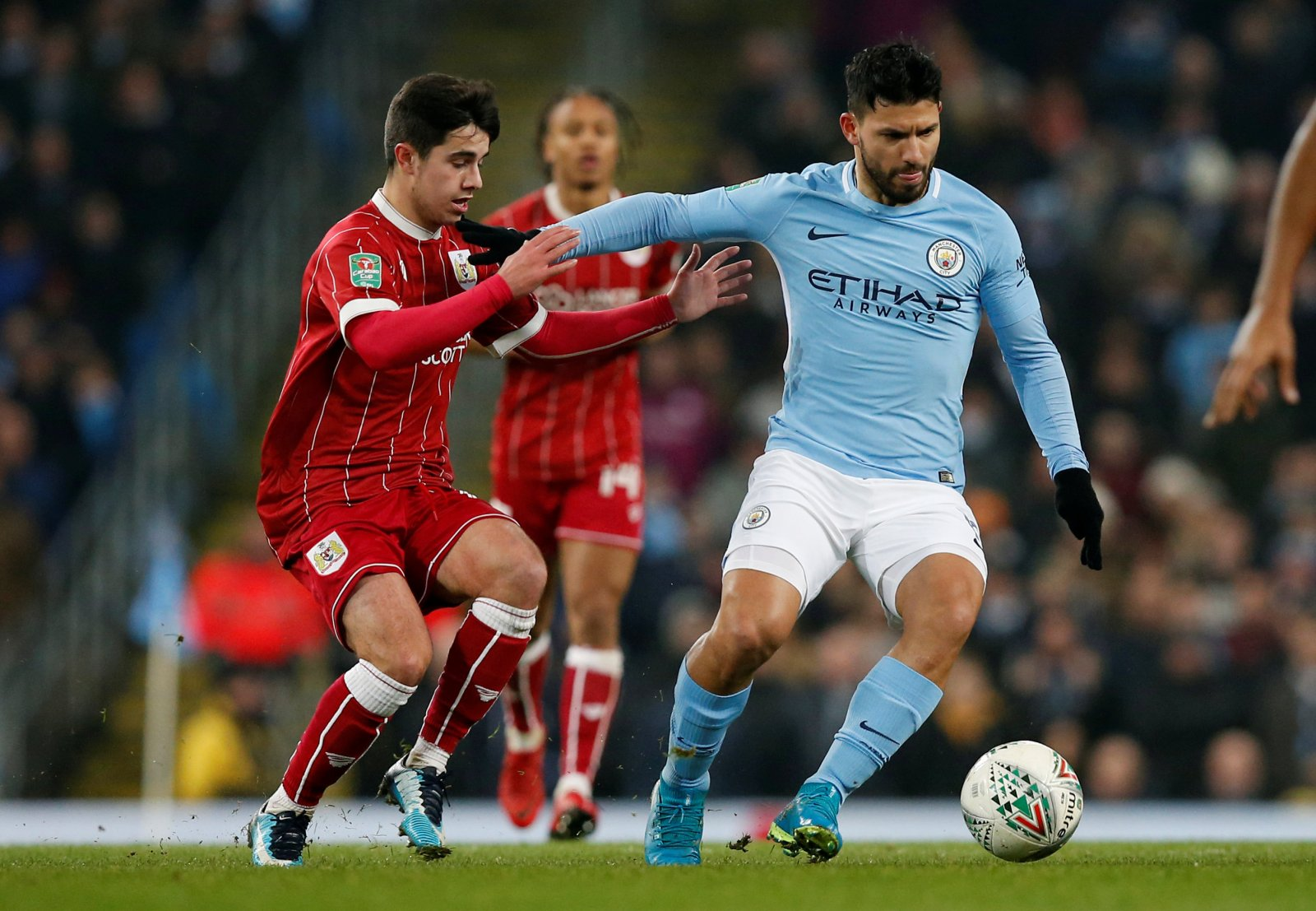 Liam Walsh (left) tracking Manchester City striker Sergio Agüero (right) when Bristol City visited the Etihad in January 2018